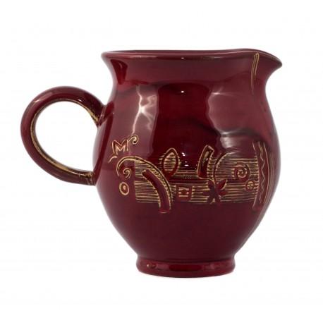 Raudonas keramikinis puodelis